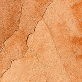 Cracked orange wall texture background — Stock Photo
