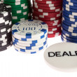 Casino and dealer chips — Stock Photo