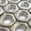Stock Photo: Metal nuts background