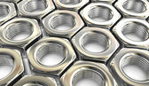 Metal nuts background — Stock Photo