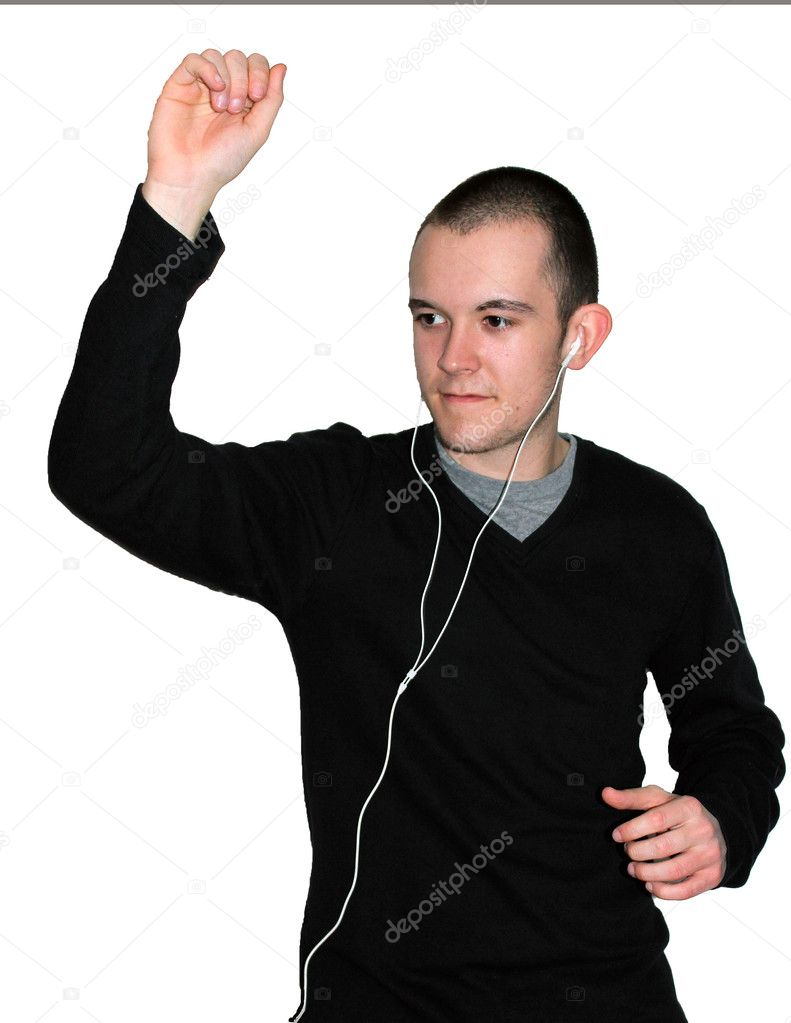 Teenage caucasian male with earphones in listening to music and dancing silly with one arm in the air — Stock Photo #10417274