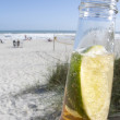 Bottle of Beer with Lime on the Beach — Stock Photo