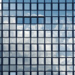 Mirror reflection of clouds in windows of a building — Stock Photo