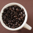 Cup of coffee (beans) — Stock Photo
