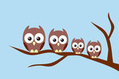 Owl family sitting on a tree — Stock Vector