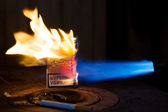 Pack of cigaretts in a flame of a gas torch — Stockfoto