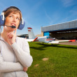 Pilot with headset outside — Stock Photo