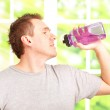 Man holding a water bottle — Stock Photo