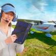 Pilot with headset and knee-pad - Stock Photo