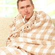 Ill man with a fever — Stock Photo #9730750