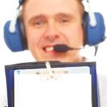 Постер, плакат: Smiling pilot showing kneepad