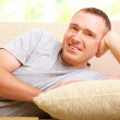 Man relaxing on sofa - Stock Photo