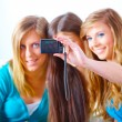 Three girls taking photos — Stock Photo