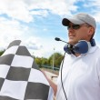 Flagman with checkered flag — Stock Photo