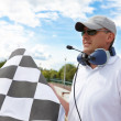 Flagman with checkered flag - Foto Stock