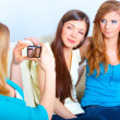 Three girls taking photos — Stock fotografie #9733571