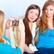 Foto Stock: Three girls taking photos