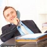Happy businessman on the phone — Stock Photo