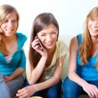 Three girls with mobile phones — Stock Photo