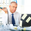 Stressed businessman sitting at desk — Stock Photo