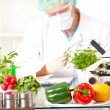 Stock Photo: Researcher with GMO plants in laboratory