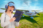 Pilot with headset and knee-pad — Stock Photo
