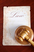 Old paper with gavel — Stock Photo