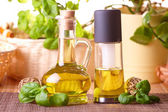 Two bottles with olive oil and grape seed oil — Stock Photo