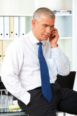 Mature businessman with phone — Stock Photo