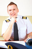 Airline pilot filling in papers — Stock Photo