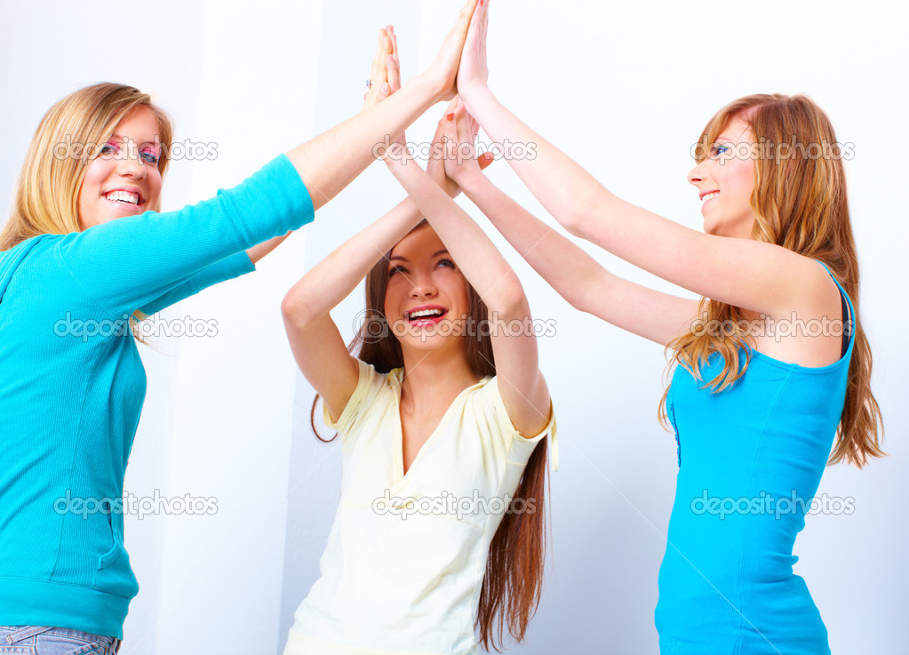 Three happy friends, beautiful girls giving a five — Stock Photo #9735894