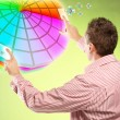 Man picking colors — Stock Photo
