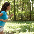 Stock Photo: Young woman running
