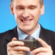 Stock Photo: Business musing his mobile phone