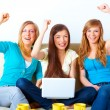 Beautiful successful girls with laptop - Stock Photo