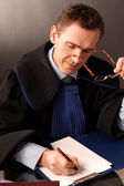 Attorney wearing classic gown in his office — Stock Photo