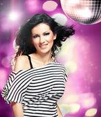 Woman in a disco — Stock Photo