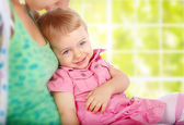 Monther with a smiling child — Stock Photo