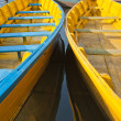 Bright colored wooden boats in Pokhara - Stock Photo