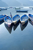 Bright colored wooden boats in Pokhara — Stock Photo