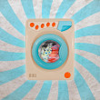 Stock Photo: Concept of colorful washing machine with retro background