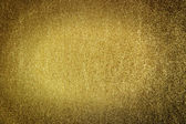 Gold dust background — Stock Photo