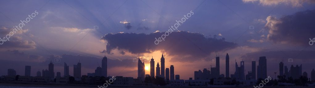 High resolution panoramic view of dubai skyline with beautiful clouds and sunrise background, consist of 3 landscape shots. — Stock Photo #9770737