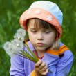 Sad girl with dandelions — Stock Photo #9725387