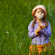 Girl with a dandelion in the hands of — Stock Photo