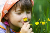Girl smelling a flower — Stock Photo