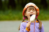 Girl bitten by ice cream — Stock Photo