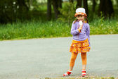 Girl with ice cream stands — Foto Stock