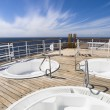 Three hot tub on the deck of a cruise - Stock Photo