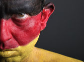 Man with his face painted with the flag of Germany — Stock Photo